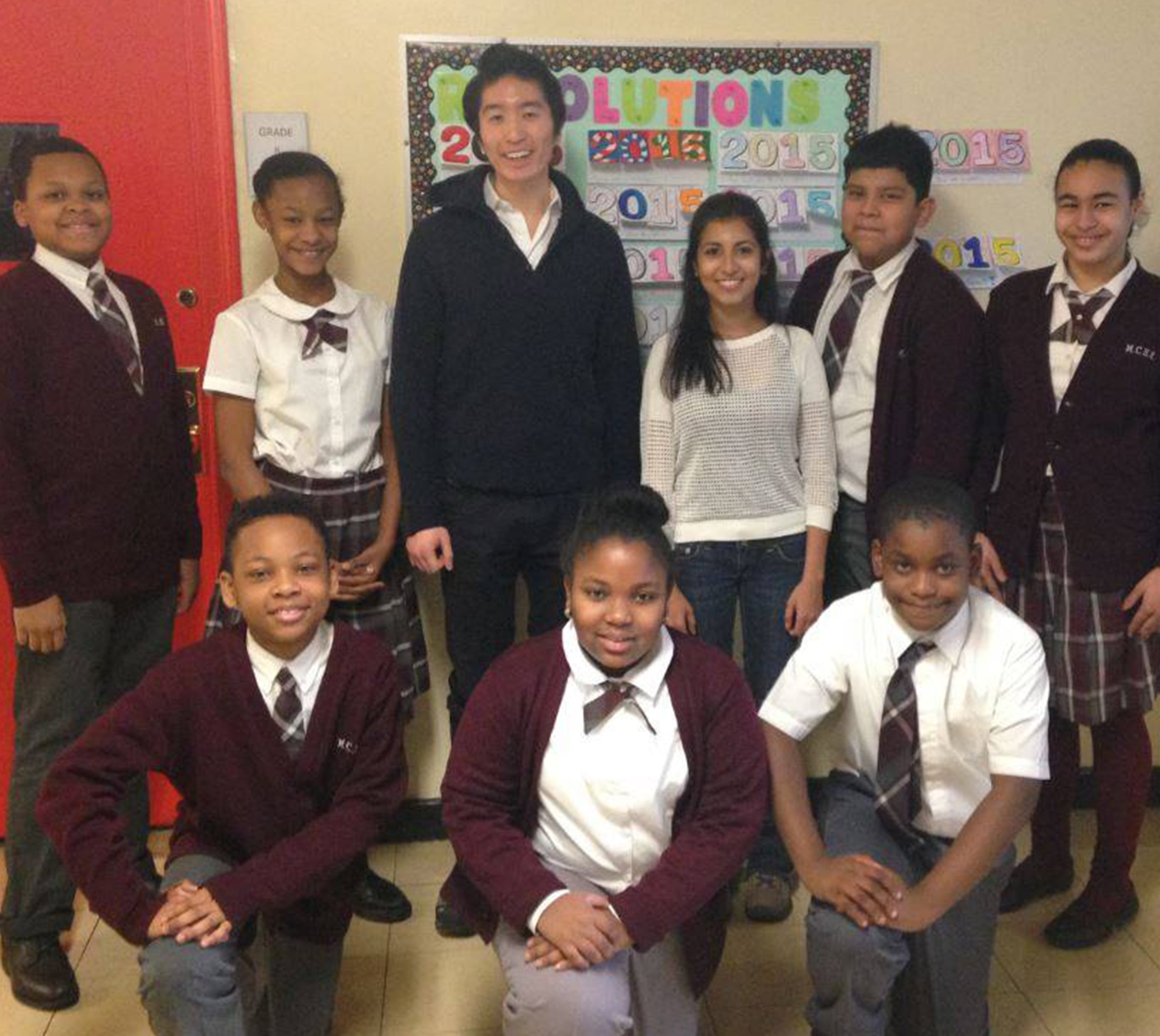 Kevin Song and Rohini Kadle (center) met with students at East Harlem's Mt. Carmel-Holy Rosary School the day before they set off for Tanzania.